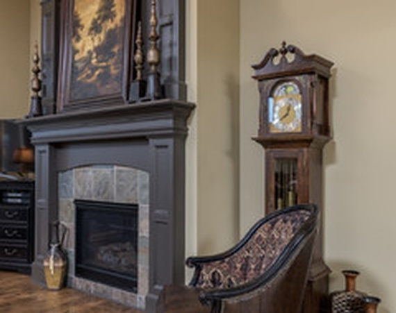 Grandfather Clock near a Fireplace in Living Room