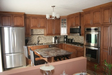 Medium Stain Kitchen Renovation Edmonton by ELITE KITCHENS INC.
