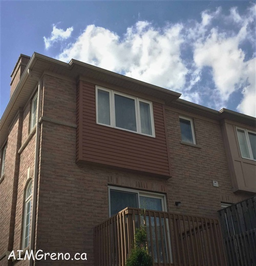 After Window Siding Replacement Service by AIMG Inc