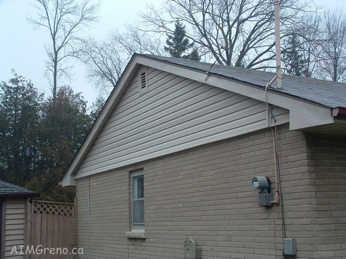 After Siding Repair Service by AIMG Inc