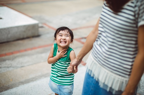 smiling-toddler-holding-hands-with-mom-in-park-522302203-5988ed716f53ba00110610ab.jpg