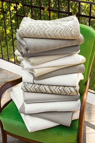 Pile of Printed Blankets on a Chair - Luxury Blankets at The Silver Peacock Inc