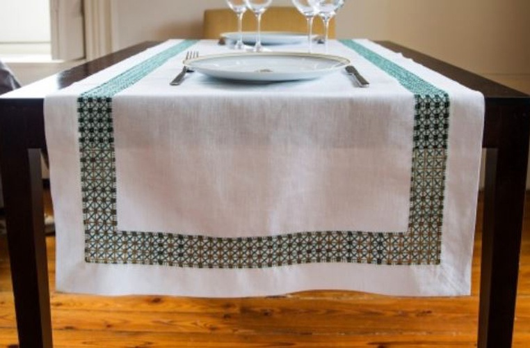 Luxury Table Linens with decorative border at The Silver Peacock Inc