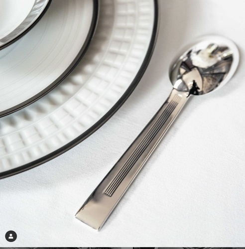 Stainless Steel Spoon Beside White Ceramic Plate - Art Deco Silverware at The Silver Peacock Inc