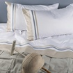Luxurious customized Bed Linen and Pillows at The Silver Peacock Inc