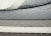 Grey and White Quilts at The Silver Peacock Inc - Luxury Vacation Home Outfitter