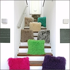 Multicolor Faux Fur Pillows on Staircase - Faux Fur Throws at The Silver Peacock Inc.