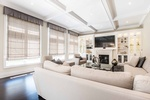 Family Room Custom Wall Unit by PARSONS INTERIORS LTD.
