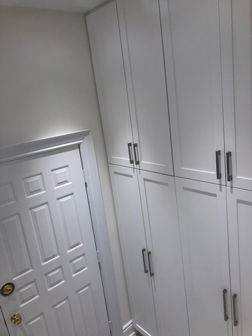 Laundry Room Closet - Custom Cabinets Oakville by Parsons Interiors Ltd.