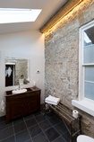 Modern Bathroom in a Heritage Home by The Architect Builders Collaborative Inc