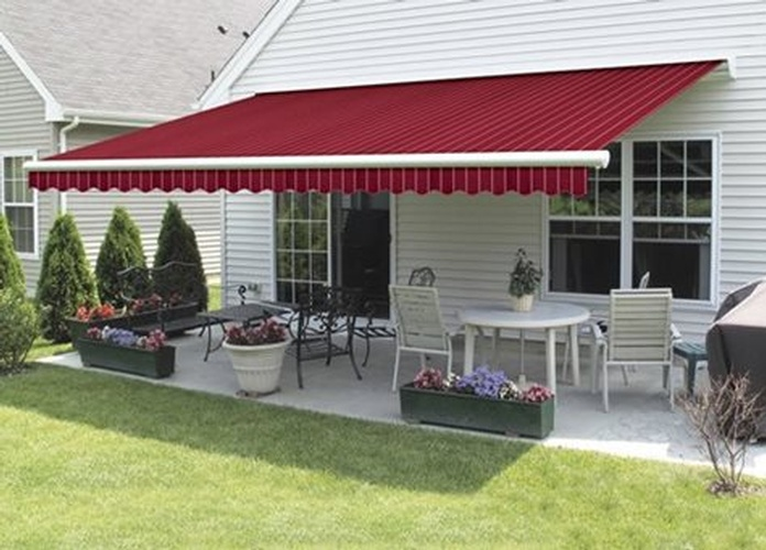 Retractable Awnings bring much valued shade to your porch, deck or patio. Convenient and easy to operate, our attractive fabric awnings provide shade at your fingertips. Enjoy the sun when you want to sunbathe or take the chill off an early spring day, and simply push a button or tap your app when the sun becomes too hot to handle.When adding shade to your outdoor living space, Aristocrat Awnings block up to 94% of the sun's harmful UV rays, and they decrease the sunlight entering your home. This lowers your air conditioning costs and reduces fading of your interior window treatments and furnishings. With so many benefits, Retractable Awnings do more than look great while adding shade.