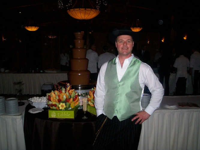 Waiter Standing near Table with food