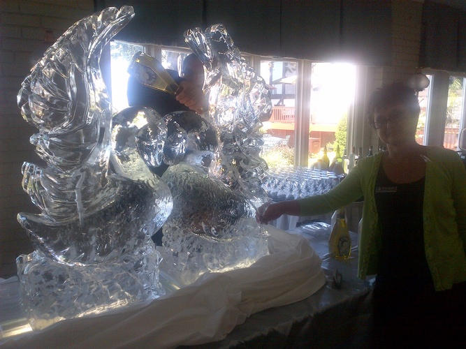Swan Ice Sculpture for Wedding by Festive Ice Sculptures