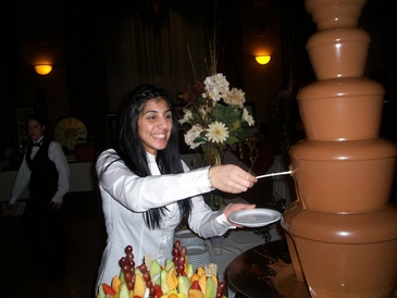 Girl Standing near Chocolate Fountain
