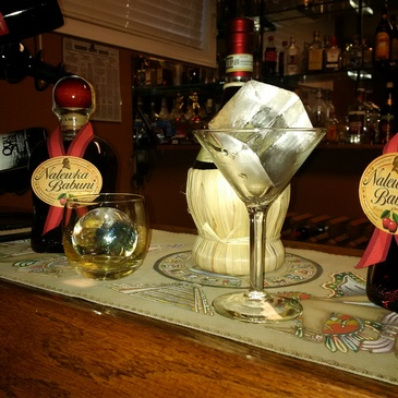 Wine Glass containing Ice cube on Bar Counter