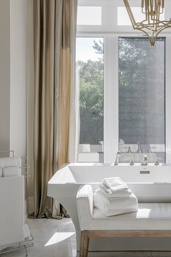 Folded White Bath Towels Placed on Upholstered Bathroom Bench - Bathroom Renovations in GTA by Royal Interior Design Ltd