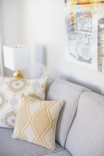 Yellow Throw Pillows on Couch - Living Space Renovations Richmond Hill by Royal Interior Design Ltd