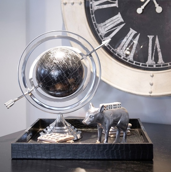 Animal Figurine and Globe in a Black Wooden Tray Kept on Table Besides Analog Wall Clock