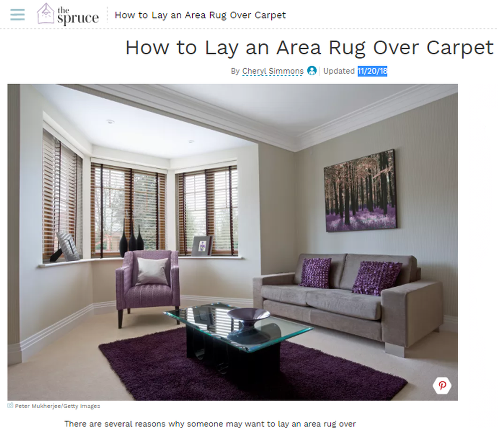 How to Lay an Area Rug Over Carpet.png