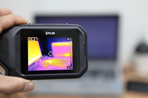 A thermal camera focusing on a laptop.
