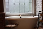Modern Freestanding White Bathroom Bathtub Design by Old Castle Home Design Center