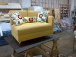 Upholstered Loveseat with Three Multicolored Floral Throw Pillows