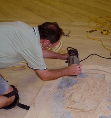Installing Floor Medallion - Sand and finish white oak.
