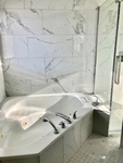 Corner Bathtub - Bathroom Renovations Hanmer by INTERIORS by NICOLE