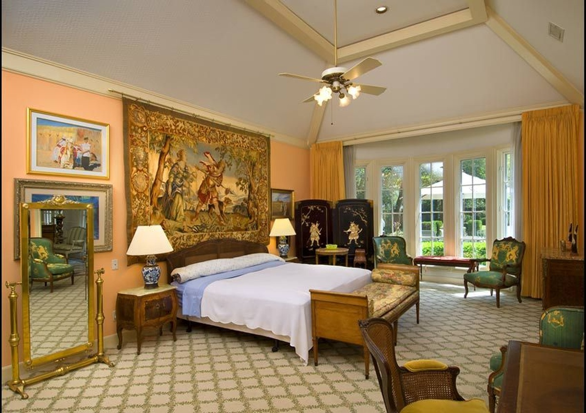 Hotel room interior with a painting hanging above the bed - Architectural Photography by Joe Robbins in Houston