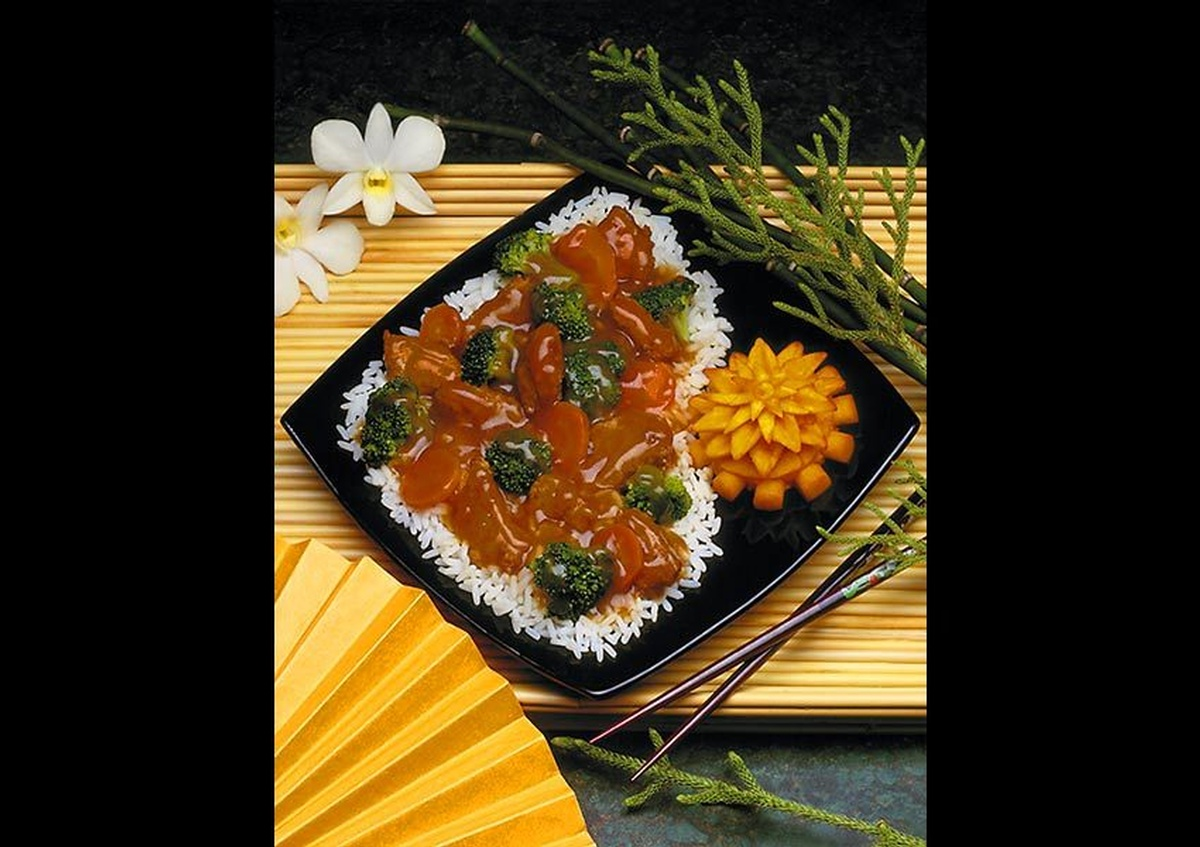 A rice plate placed on a serving tray with chopsticks on the side - Food Photography Services by Joe Robbins in Texas