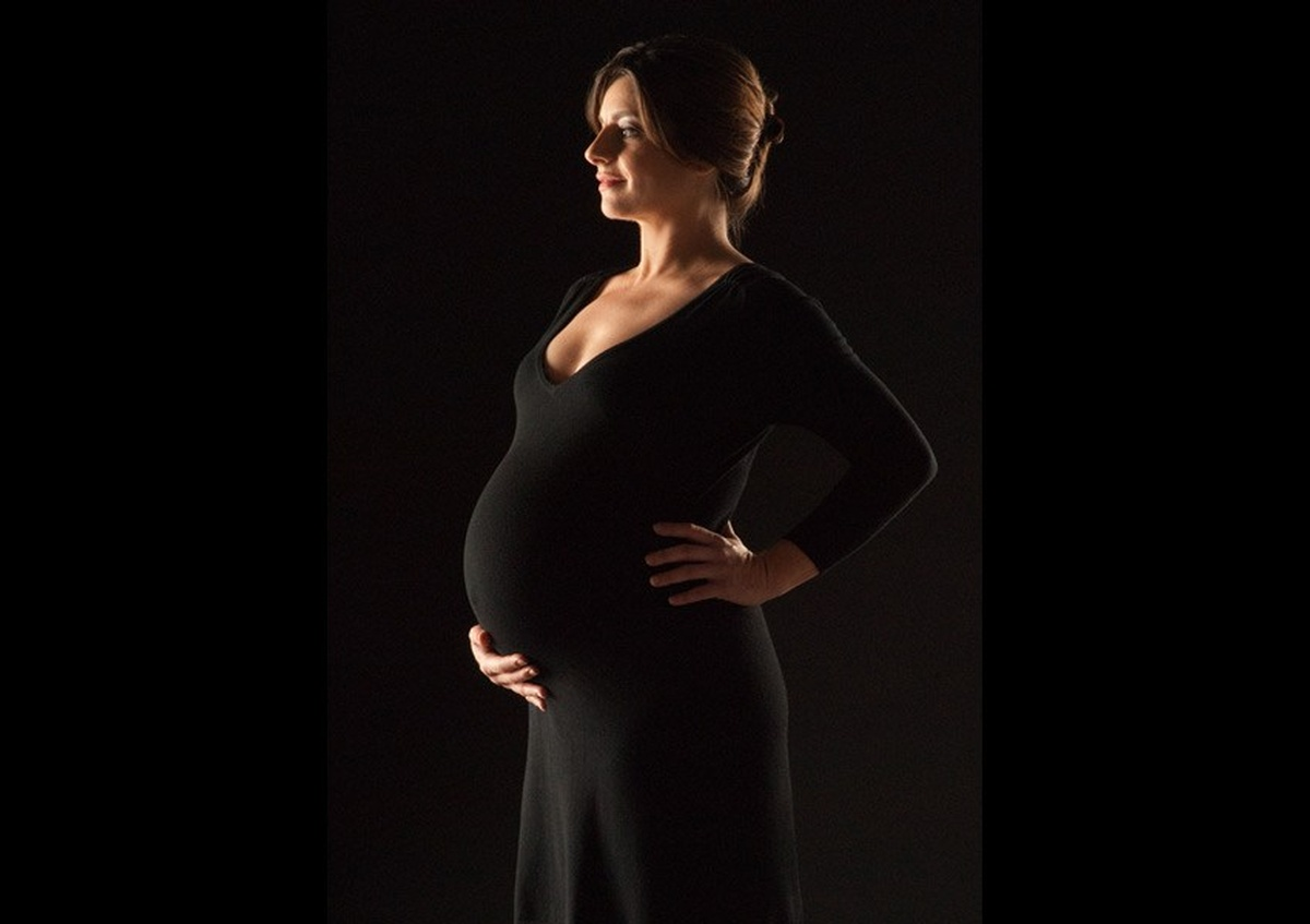 Maternity Photoshoot of a woman dressed in black - Professional Photography in Houston by Joe Robbins
