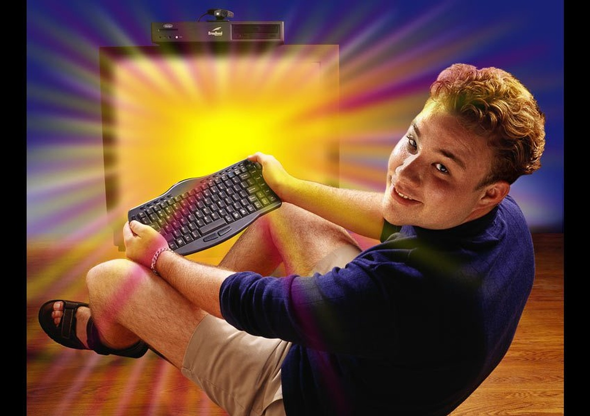 Man Holding Black Wireless Computer Keyboard - Joe Robbins Photography