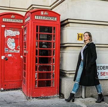 Women Walking Near Telephone Booth - London Travel Photography by PicVoyage