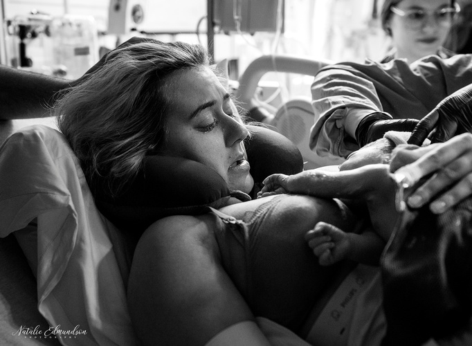Mother Holding Newborn Baby in Hospital - Natalie Edmundson Photography