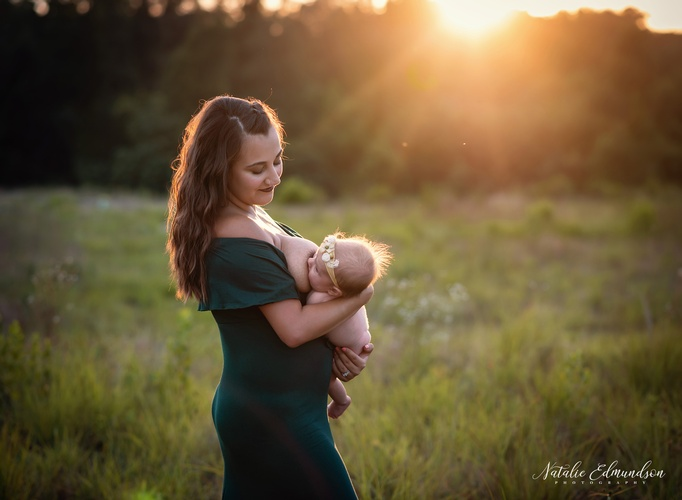 Mother Breast Feeding Child Captured by Natalie Edmundson