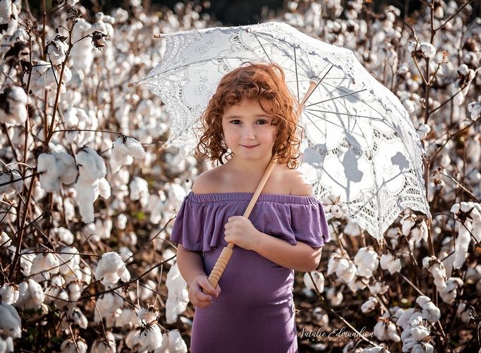 Young Girl  with umbrella Captured by Natalie Edmundson