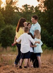 Happy family hugging in Grovetown GA Captured by Natalie Edmundson Photography