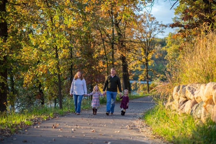Family Walking on Pathway Surrounded by Trees - Professional Photography Services by Family Photographer Farmington