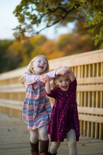 Two Girls Playing Captured by Minnesota Photographer - Professional Kids Photography Services