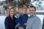 Smiling Parents with two young sons Captured by Family Photographer Minneapolis - Mode T Productions