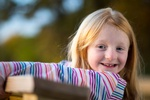 Girl wearing Striped Tshirt -Kids Photography Services by Apple Valley Photographer at Mode T Productions