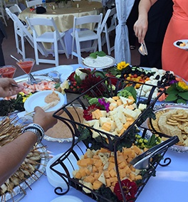 A Table with a variety of dishes by Christie's Catering - Event Catering Tacoma