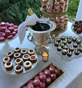 A bottle of wine among a variety of sweets at an Event Catering by Christie's Catering in Tacoma
