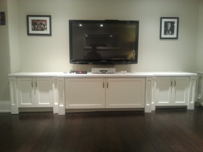 Flat screen TV on white finished wood cabinets Oakville by Finished Basements