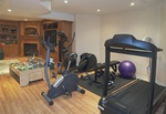 Exercise Equipments in Living room with wood Cabinets by Finished Basements in Oakville