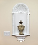 Brown and gold urn on wall Shelf