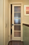 Slightly Ajar white wooden sliding door
