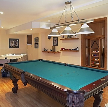 Pool Table in a room renovated by Toronto Renovation Contractor - Finished Basements