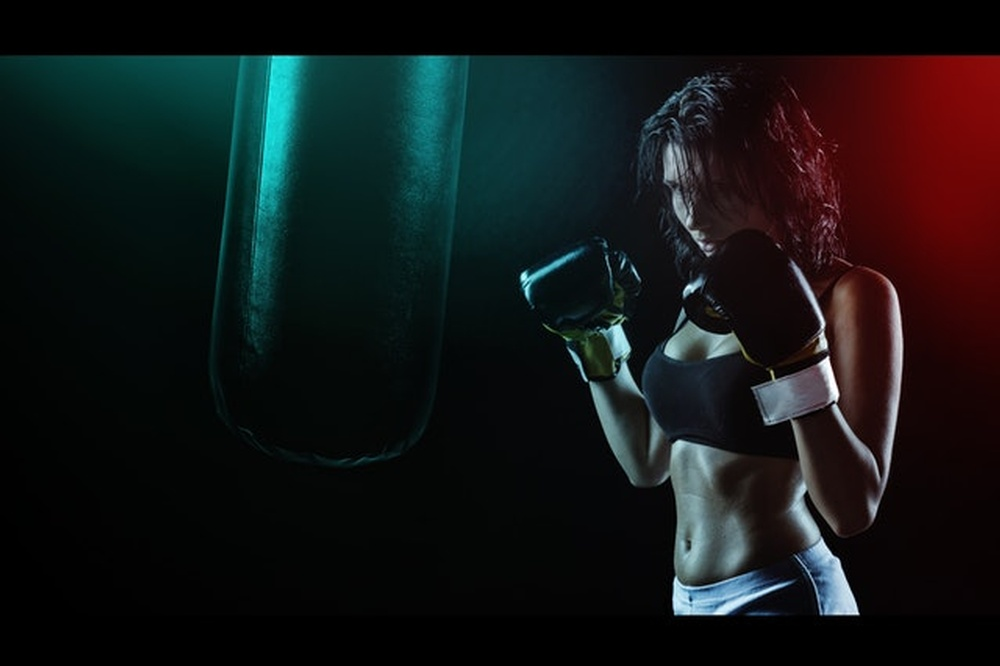 woman-in-boxing-gloves-with-sports-bra-posing-boxing-style-163351 (1).jpg