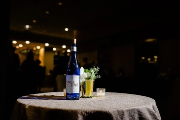 Bottle of Wine on Table - Photography Services Aurora by Visual Filmworks